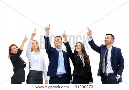 business people in a row pointing and looking up to copy space