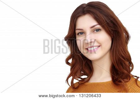 Pretty girl in orange sweater with curly hair on white background