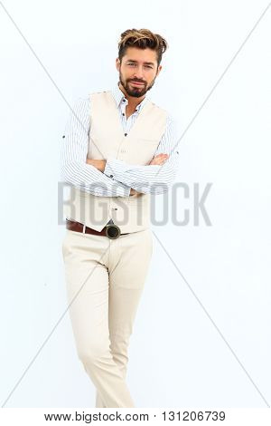 portrait of a stylish young man standing posing