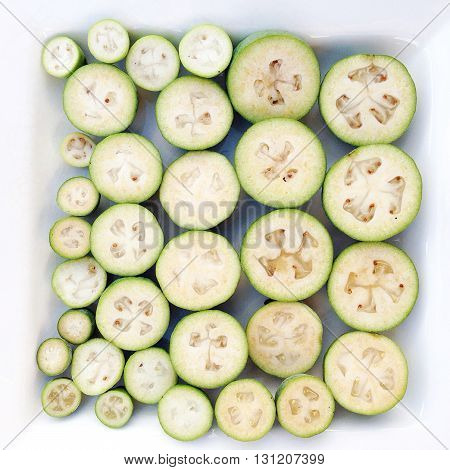 Feijoas (pineapple guava) in a white dish ready for cooking or baking