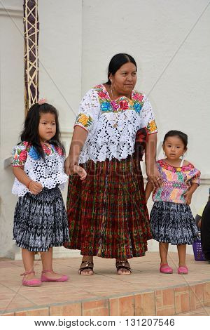SANTA CRUZ GUATEMALA MAY 03 2016: Portrait of a Mayan children and mother. The Mayan people still make up a majority of the population in Guatemala.