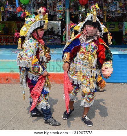 SANTA CRUZ GUATEMALA MAY 03 2016: Guatemalan fiesta Masked dancers in traditional dance costume Guatemala Dance of the Conqueror Central America