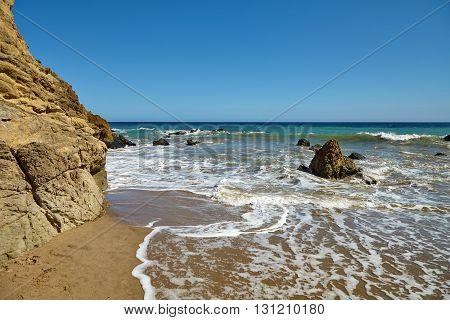 Waves beating against coastal rocks on the cliffs in Malibu California