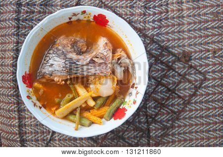 Spice sour soup made of Tilapia fish cucurbita and tamarind paste