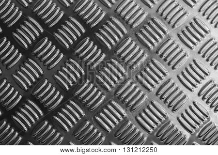 metal plate close-up in black and white sceneemboss pattern texture of metal plate or metal sheet for anti-slip