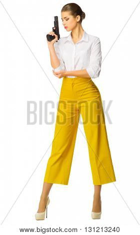 Young woman in yellow with gun isolated