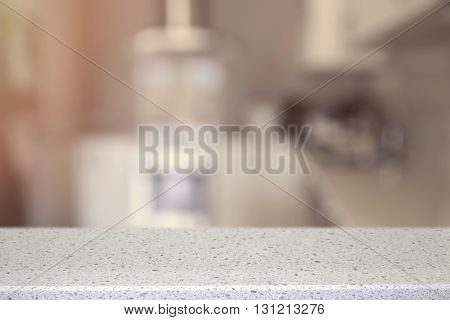 White Quartz Stone counter top with blur kitchen background soft selective focus vintage tone product display template