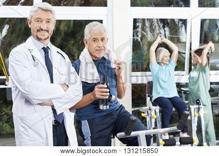 Confident Senior Man And Doctor In Fitness Studio