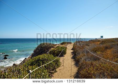 Footpath to the malibu beach, California USA
