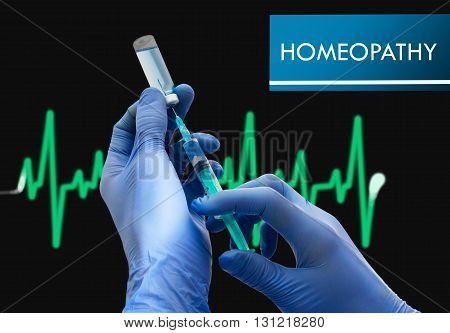 Homeopathy. Syringe is filled with injection. Syringe and vaccine. Medical concept.