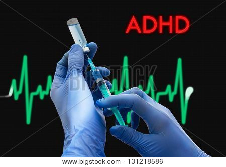 Treatment of ADHD (attention deficit disorder). Syringe is filled with injection. Syringe and vaccine. Medical concept.