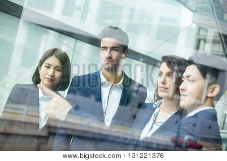 Business people discuss inside office