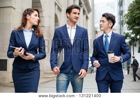 Group of business people walking at outdoor