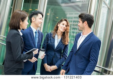 Group of business people talking at outdoor