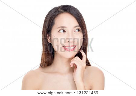 Asian woman with perfect skin and looking away