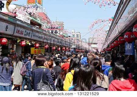 TOKYO-MARCH 29 : Nakamise shopping street in Asakusa, Tokyo on 29 March 2016.The Senso-ji Buddhist Temple in Asakusa is the most famous temple in tokyo for tourists to visit.