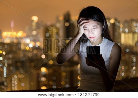 Woman suffer from headache when use of mobile phone at night