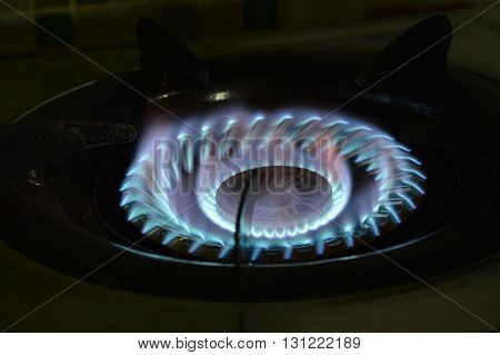 flame on gas stove in  home kitchen