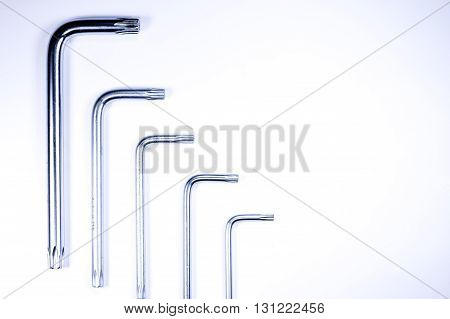 hex keys on white. industrial equipment detail