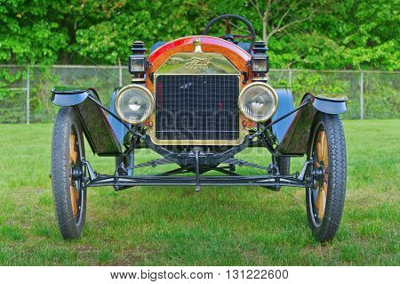 Essex, CT USA - 24 May 2011: Vintage 1900s Ford motorcar on display at Tuesday Evening Car Show. This revered New England tradition brings together car enthusiasts from all eras on village greens to display restorations of their previous winter months' wo
