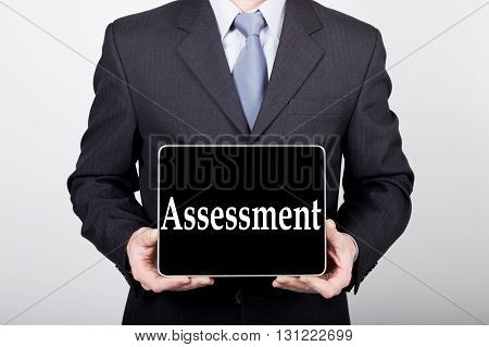 technology, internet and networking in business concept - businessman holding a tablet pc with assessment sign. Internet technologies in business.
