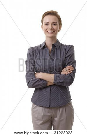 Portrait of confident young smiling businesswoman over white background.