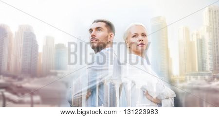 business, partnership, success and people concept - businessman and businesswoman standing over dubai city background with double exposure effect