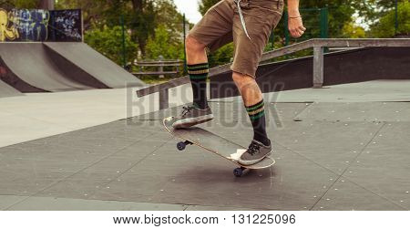 Man riding a skateboard in the park.