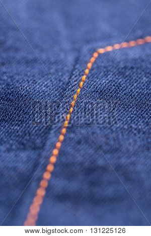 Blue jeans texture with seam, close up