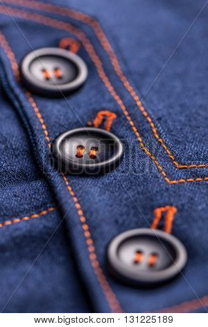 Buttons on denim skirt close up shot