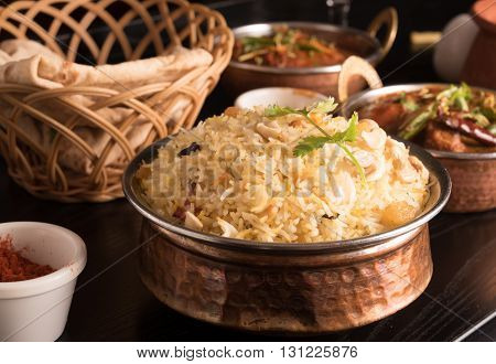 Yummy delicious biryani in a round brass bowl