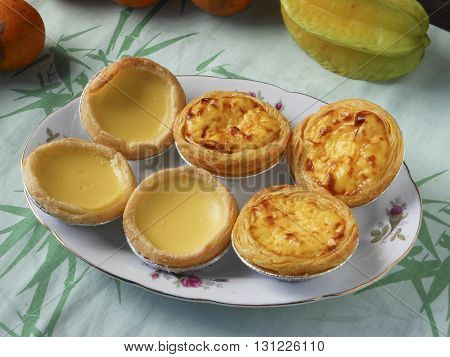 Chinese Guangzhou classic dim sum nutritional breakfast. Meringue egg tarts and Portuguese egg tarts.