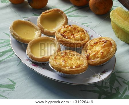 Meringue egg tarts and  Portuguese tarts. Tea break desserts.