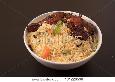 Indian fried Chicken Biryani/Biriyani in a white bowl