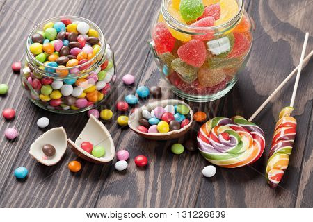 Colorful candies on wooden table background