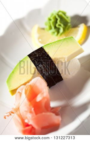 Japanese Cuisine -  Avocado Nigiri Sushi with Ginger and Wasabi