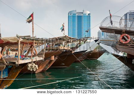 Abu Dhabi Buildings Skyline With Old Fishing Boats