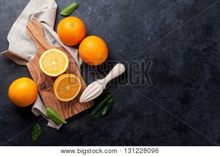 Fresh orange fruits on stone table. Top view with copy space