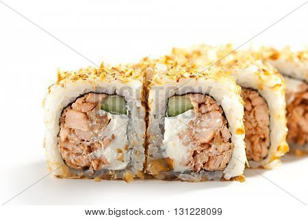 Bonito Maki Sushi - Rolls with Fried Salmon, Cucumber and Cream Cheese inside. Dried Shaved Bonito outside