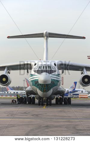 MOSCOW, RUSSIA - SEPTEMBER 26, 2014: Cargo airplane IL-76TD Alrosa airlines parked Domodedovo airport.
