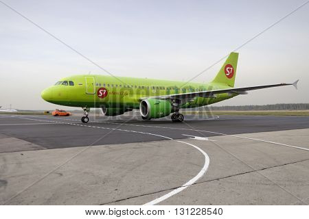 MOSCOW, RUSSIA - SEPTEMBER 26, 2014: S7 airlines Airbus A319 taxiing. Plane makes taxiing on taxiway Domodedovo International Airport.