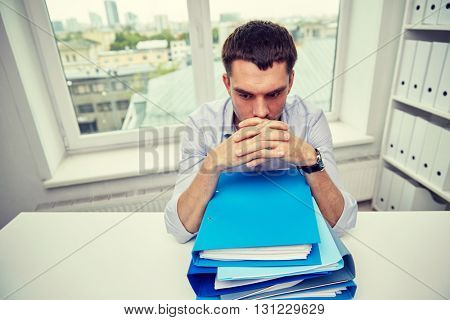 business, people and paperwork concept - businessman taking papers from secretary in office