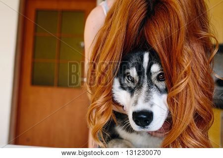 young woman with her hair covered a dog