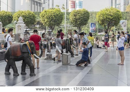 BANGKOK THAILAND - APR 17 : Unidentified people worship in Trimurati shrine at Central world in Ratchaprasong area on april 17 2016. Thailand. Trimurati shrine is one of sacred item in Ratchaprasong area