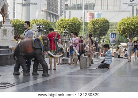 BANGKOK THAILAND - APR 17 : people pray to Trimurati shrine at Central world in Ratchaprasong area on april 17 2016. Thailand. Trimurati shrine is one of sacred item in Ratchaprasong area