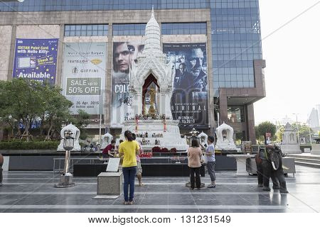 BANGKOK THAILAND - APR 17 : people worship in Trimurati shrine at Central world in Ratchaprasong area on april 17 2016. Thailand. Trimurati shrine is one of sacred item in Ratchaprasong area