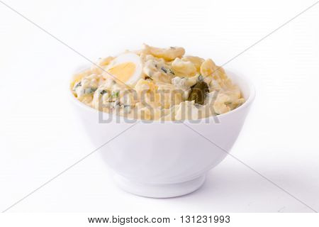 Potato Salad in white bowl on white plain background.
