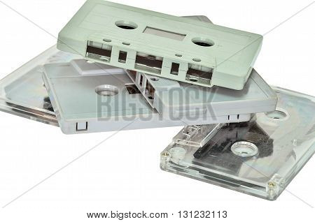 Audio cassette and tape on white background