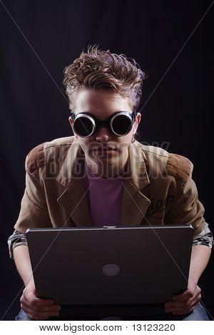 Portrait of a teens(hacker, student). Shot in studio.