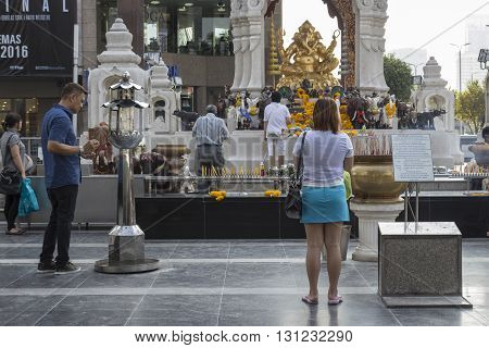 BANGKOK THAILAND - APR 17 : people worship in Ganesha shrine at Central world in Ratchaprasong area on april 17 2016. Thailand. Ganesha shrine is one of sacred item in Ratchaprasong area